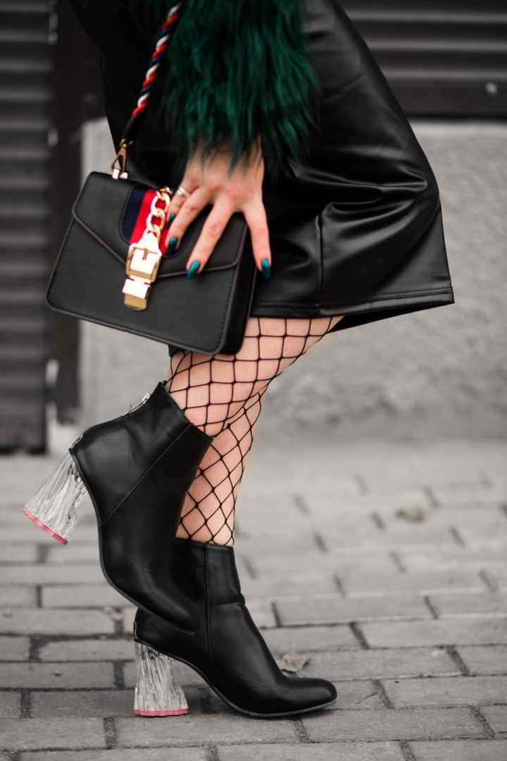 person wearing black chunky heeled boots