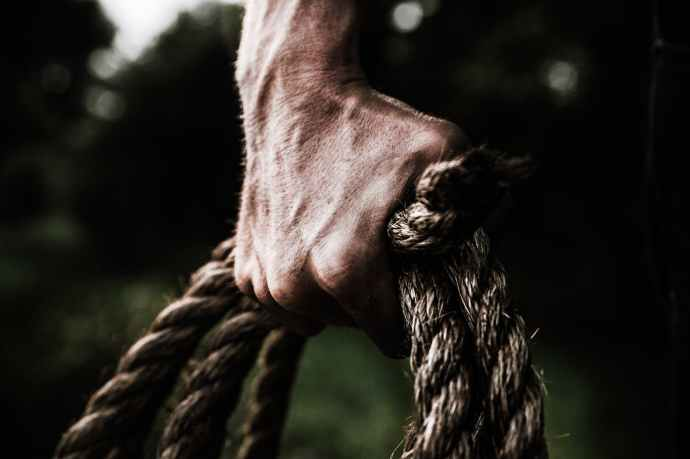 man holding brown rope