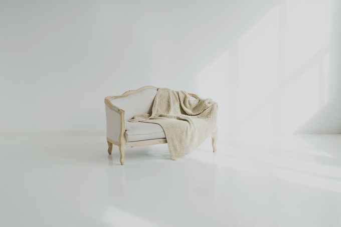 white towel on white wooden sofa